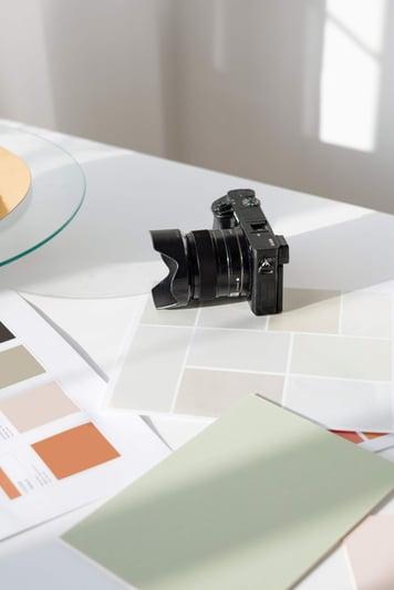 camera-on-desk-paint-chips-design-layout