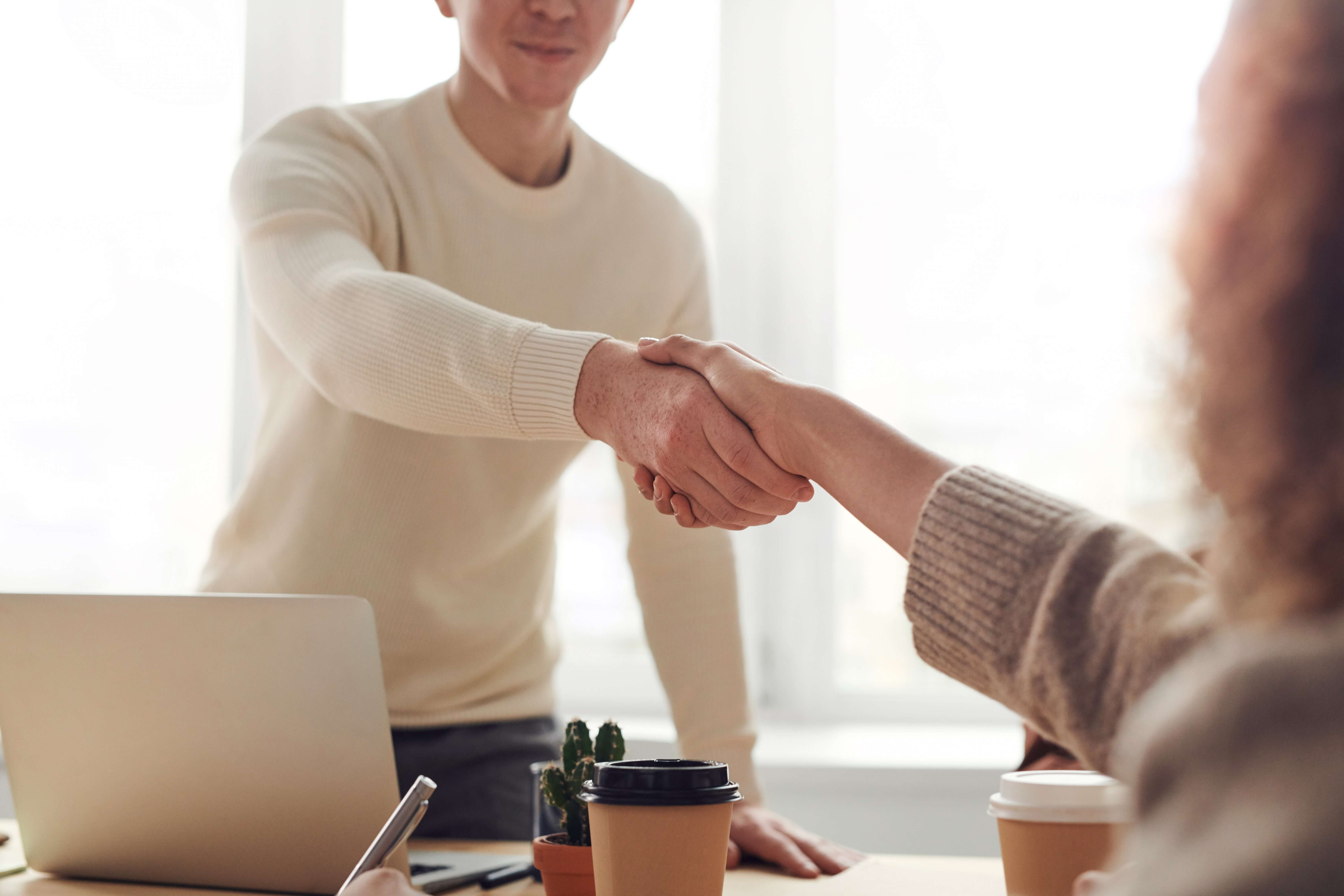people_shaking_hands_business_deal